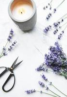 Lavender flowers, candle and scissors photo