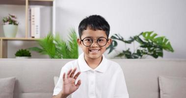 Boy smiling and waving hand. video