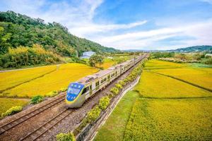 Train on the field in Miaoli, Taiwan photo