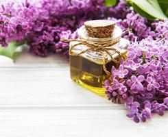 Spa oil with lilac flowers photo