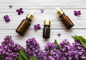 Essential oil with lilac flowers photo
