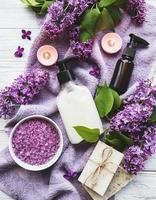 Spa setting with lilac flowers photo