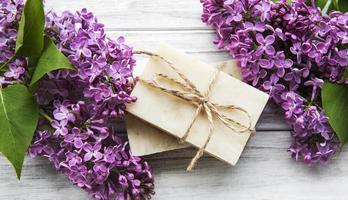 Natural soap and lilac flowers photo