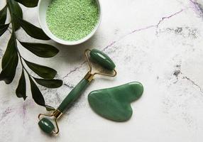 Green spa, face roller and bath salt photo