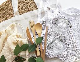Mesh bag, cotton bags and glass jars photo