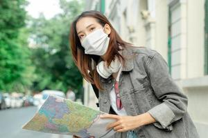 Female Asian tourist traveling during an epidemic photo
