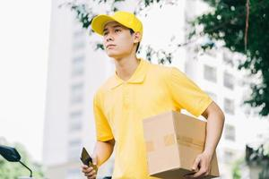 Asian delivery people are running on the road to deliver goods to customers photo