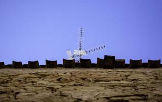 Old television antenna on a roof photo