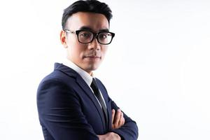 Portrait of Asian businessman with arms crossed with confidence photo