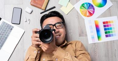 Portrait of an Asian man working by himself in the field of design photo