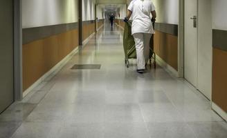 Nurse aide in hallway photo
