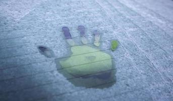 Handprint on frozen glass photo