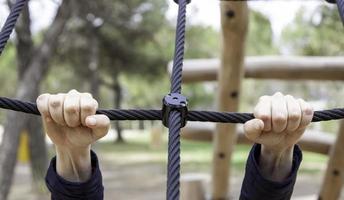 Woman grabbing ropes photo