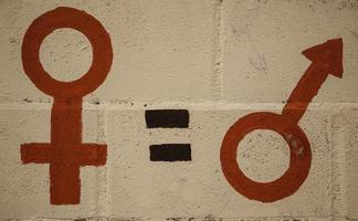 Feminist symbol on wall photo