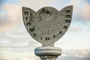 solitary sun clock photo