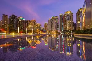 Reflection of Taichung skyline in Taiwan at night photo