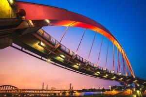 Night view of a Rainbow bridge in Taipei, Taiwan photo