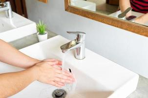 Close up woman cleaning her hands after using  toilet to prevent infection or contamination from dirty things photo