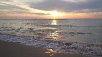 slow motion of wave hit beach and sea at sunrise video