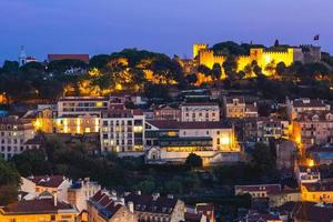 Night view of Saint Jorge Castle at Lisbon in Portugal photo