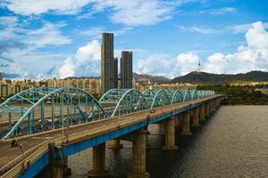 Seoul tower and Dongjak bridge over Han river in Seoul, South Korea photo