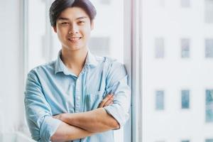Portrait of an Asian male businessman working attentively photo
