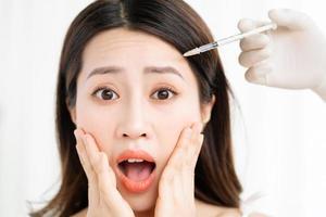 Asian woman undergoing fine carpet surgery photo