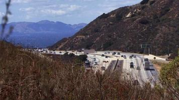 Time lapse traffic on a freeway cutting through a mountain pass. video