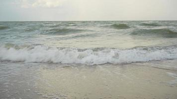 slow motion of beach and sea in morning of moody day video