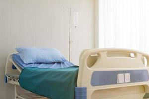 Bed in ward in hospital for sick patient to admit for treatment. medical and healthcare concept photo