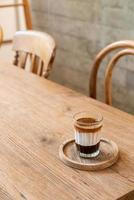 Double dirty coffee cup or espresso coffee with milk and chocolate photo
