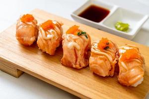 Grilled salmon sushi on a wood plate - Japanese food style photo