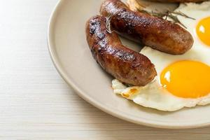 Homemade double fried egg with fried pork sausage - for breakfast photo