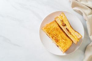 Homemade French toast with ham, bacon, and cheese sandwich with egg photo