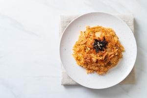 Kimchi fried rice with seaweed and white sesame - Korean food style photo