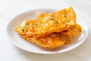 Crispy roti with sugar on plate photo