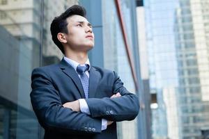 Portrait of young Asian businessman outside the office photo