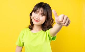 Young Asian girl with expressions and gestures on background photo