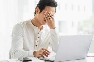 Male staff feel pressured and tired at work photo