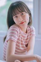Portrait of young Asian woman with fragile beauty photo