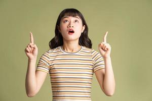 Young beautiful Asian woman posing on background photo