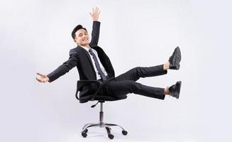 Young Asian businessman sitting on chair on white background photo