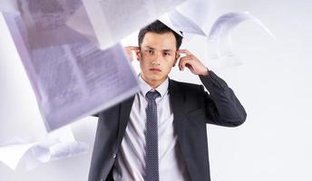 Stressed Asian businessman on white background photo