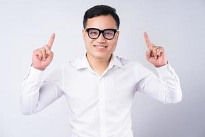 Image of Asian businessman pointing up photo