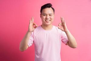 Asian man use ok hand photo