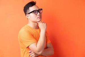 Asian man standing in thought photo