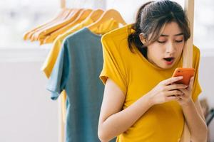 Young Asian girl addicted to using smartphones photo