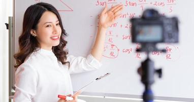Asian female teachers are recording lessons for online teaching work photo