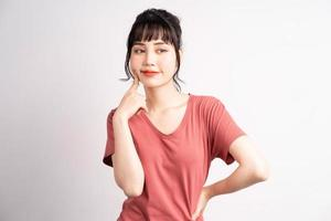 Young Asian woman posing on white background photo