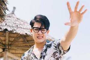 Portrait of Asian man on the beach photo